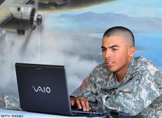 Soldier Using Laptop - Credit: Getty Images