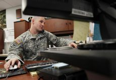 Army Reservist Keith Johnson, working at a military facility in Londonderry, N.H., has a year to go for his college degree.