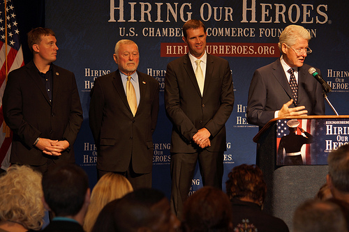 From left to right: Medal of Honor recipient Sergeant Dakota Meyer, Toyota Senior Adviser and Hiring Our Heroes Veterans Employment Advisory Council Co-Chair Don Esmond,U.S. Chamber of Commerce Foundation Hiring Our Heroes Executive Director Eric Eversole, and President Bill Clinton